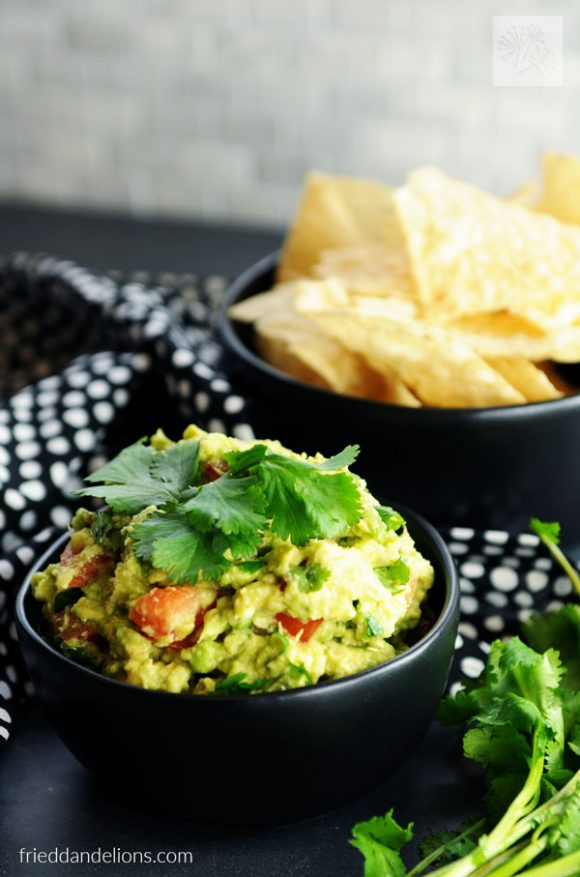 Kid Friendly Guacamole with bowl of tortilla chips in background