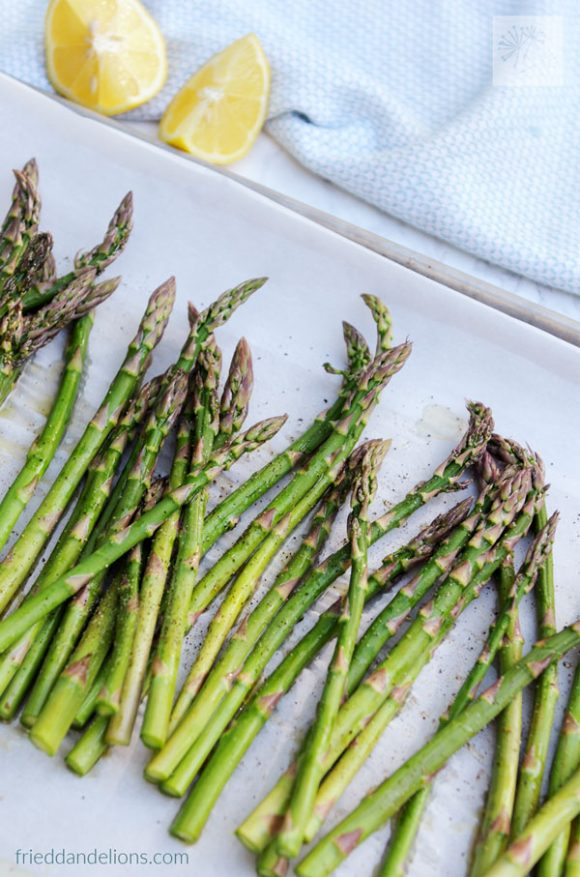 roasted asparagus with lemon prepared to go into the oven