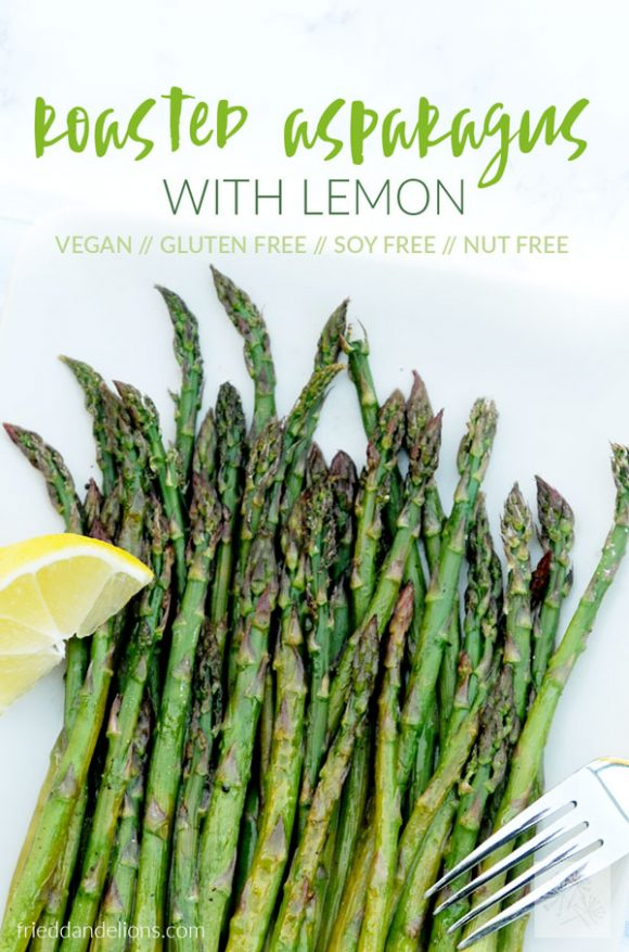 overhead shot of roasted asparagus with lemon on a plate with a white background and a lemon wedge