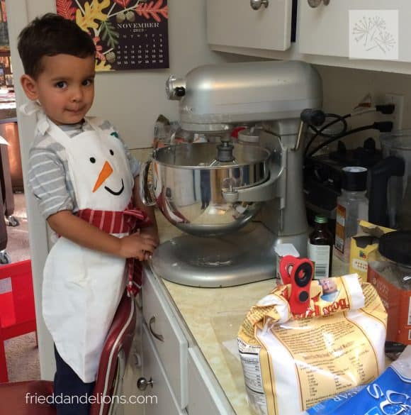 young boy making Classic Vegan Sugar Cookies with a kitchen aid mixer