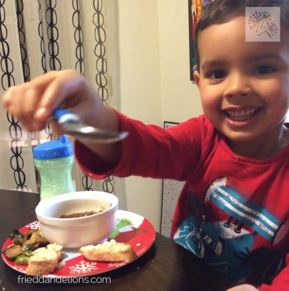3 year old David eating a bowl of vegan French Onion Soup