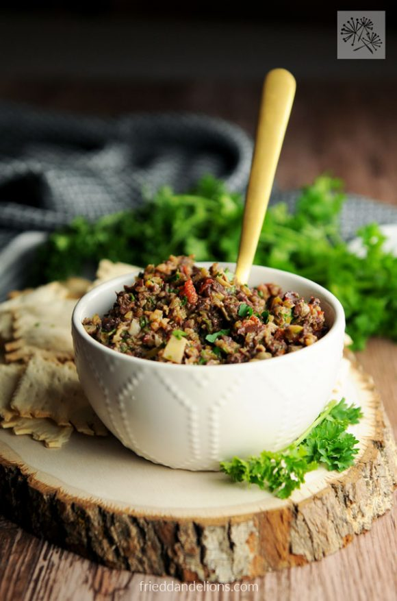 bowl of Olive Tapenade with gold spoon