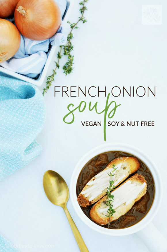 overhead view of vegan French Onion Soup with onions, gold spoon, blue napkin on white background with text overlay