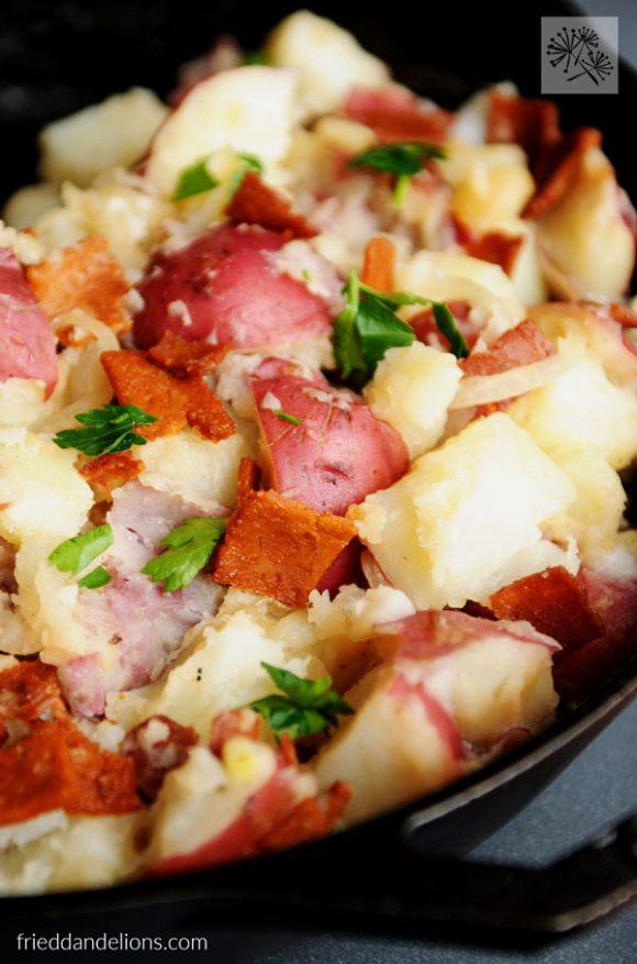close up of skillet of Vegan German Potato Salad