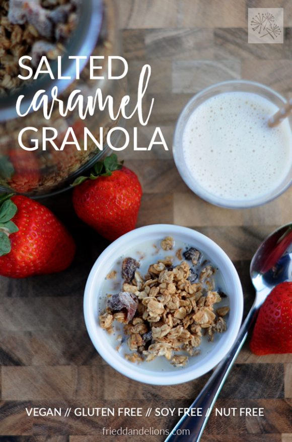 overhead view of salted caramel granola with strawberries and spoon, with text overlay