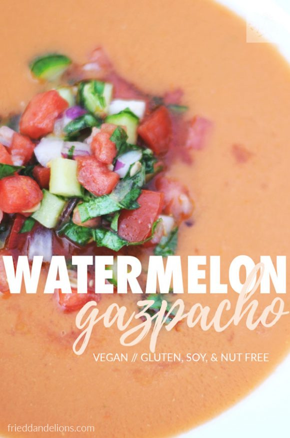 overhead view of white bowl filled with Watermelon Gazpacho topped with fresh garnish and text overlay