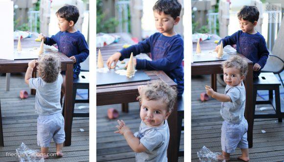2 boys eating Salted Caramel Pretzel Chunk Ice Cream