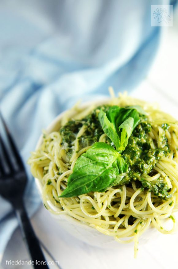 bowl of Vegan Pesto pasta with blue background