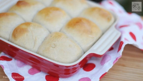 red baking dish of maple dinner rolls with aquafaba