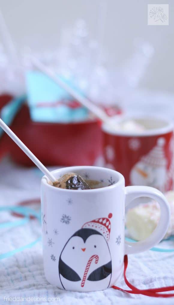 marshmallow swizzle sticks in white mug of hot chocolate