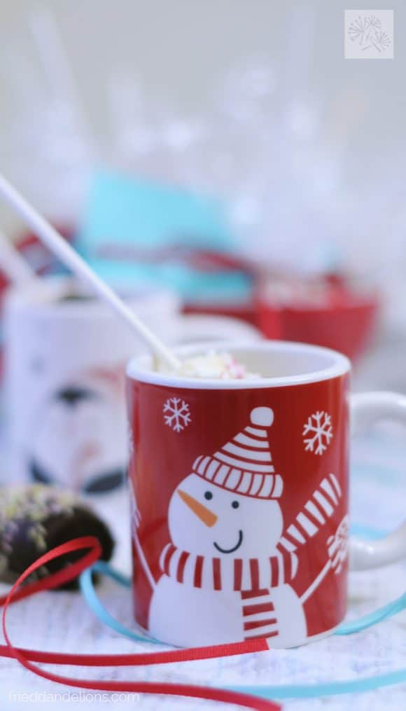 marshmallow swizzle sticks in red mug of hot chocolate