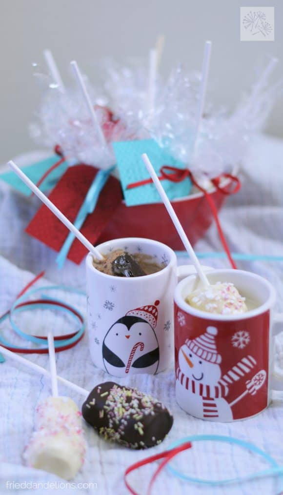 marshmallow swizzle sticks in mugs of hot chocolate
