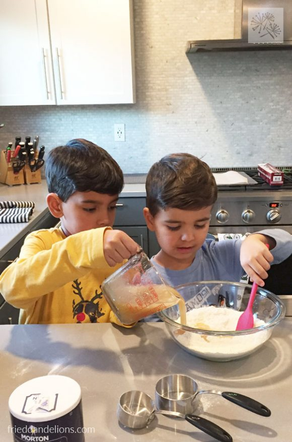 two boys baking vegan thumbprint cookies