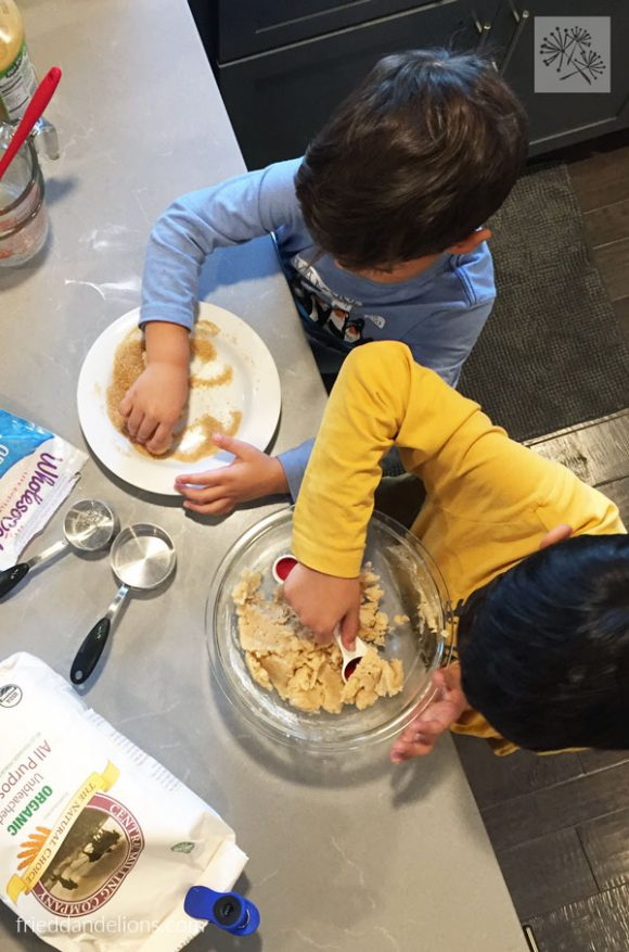 overhead view of two boys making vegan thumbprint cookies
