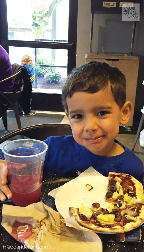 young boy finishing his pizza before eating a birthday cake with Soda Boxed Cake Mix Hack