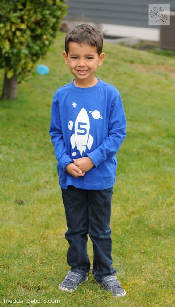 young boy wearing blue shirt ready to celebrate his birthday with Soda Boxed Cake Mix Hack