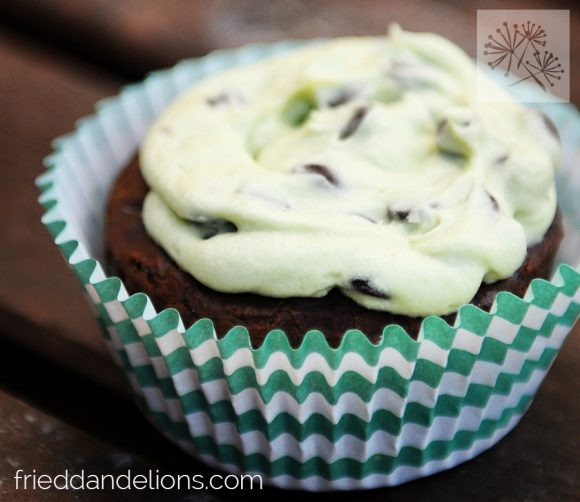 close up of vegan peppermint patty brownie cupcakes with green striped cupcake wrapper