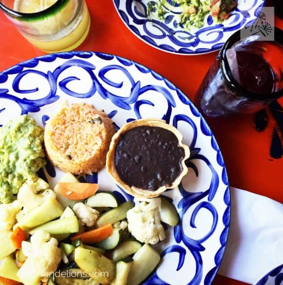 overhead view of plate at a restaurant with vegan oil free refried black beans