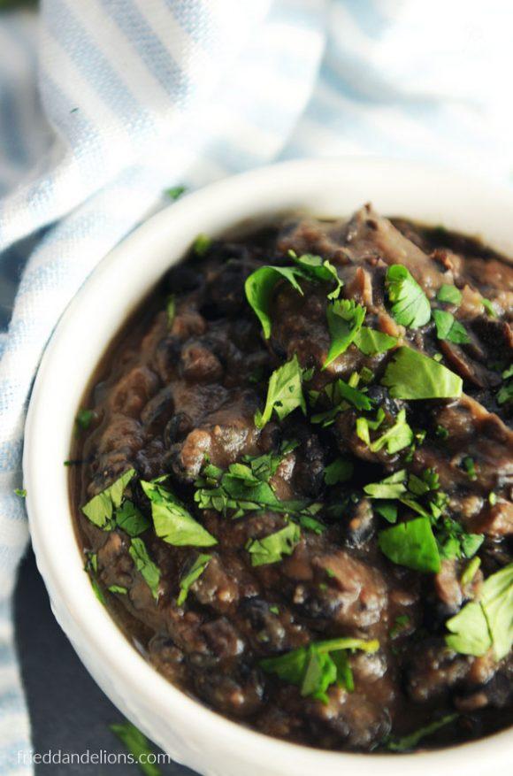 close up of bowl of vegan oil free refried black beans