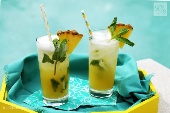 two pineapple mojitos