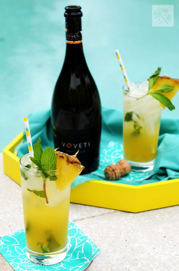 pineapple mojito sitting by pool vertical