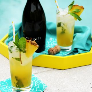 pineapple mojitos sitting by the side of the pool horizontal