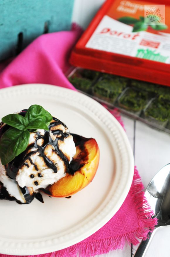 close up of grilled nectarines with Dorot basil cubes in background