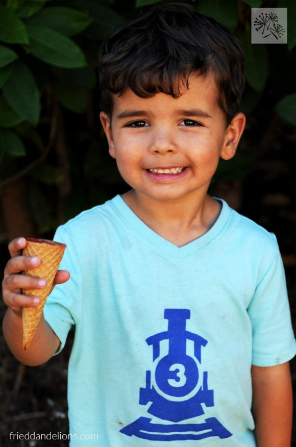 3 year old boy eating a Campfire Cone