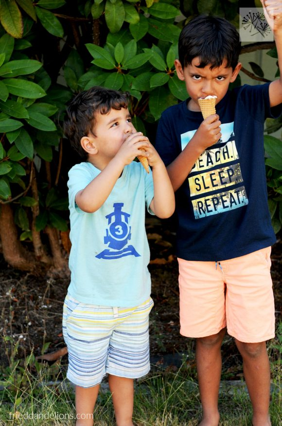 2 young boys eating Campfire Cones