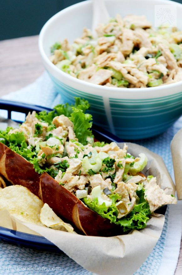 Vegan Chicken Salad with Pickles sandwich with serving bowl behind