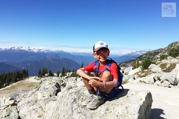 boy on top of Blackcomb Mountain