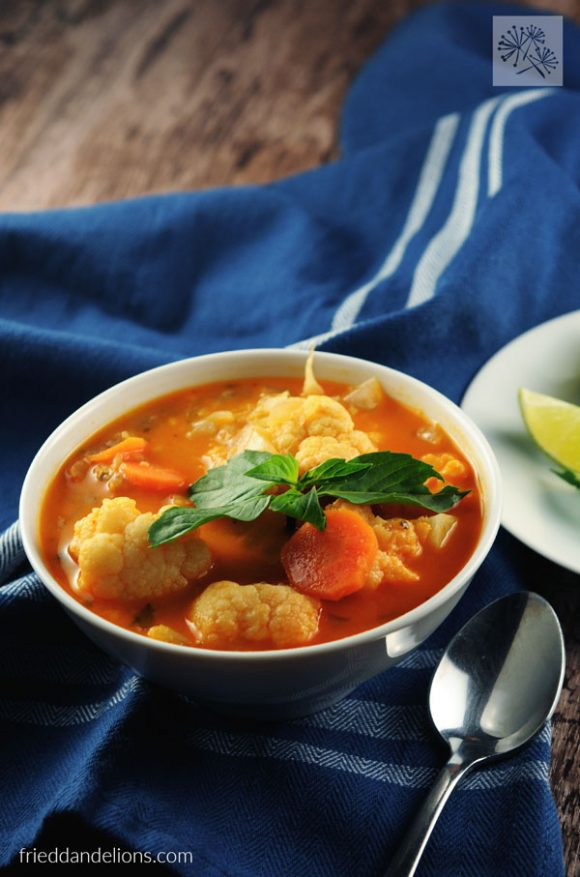 close up shot of Red Curry Soup with Lentils by Vegan Richa