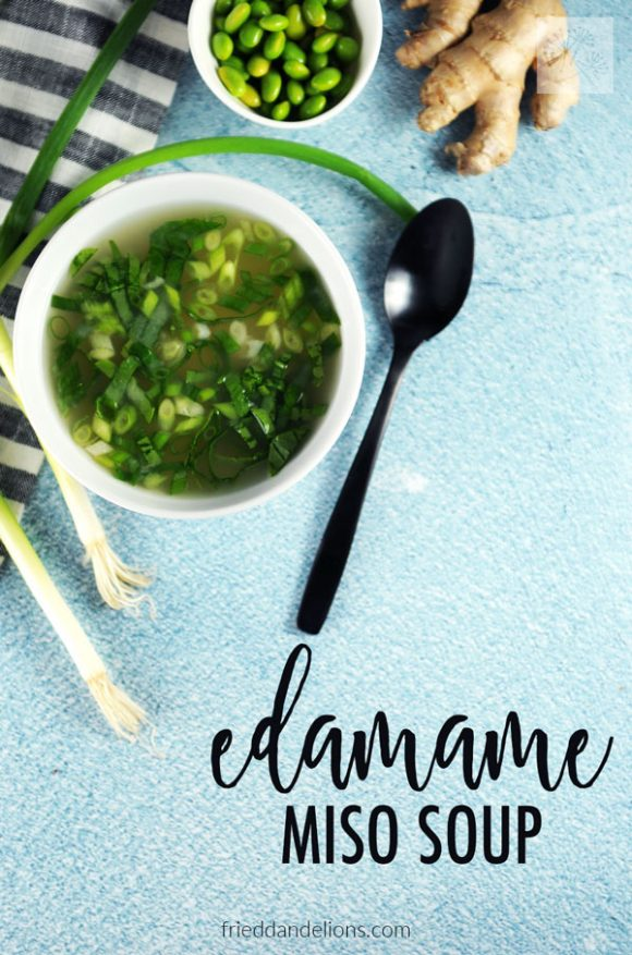 overhead of edamame miso soup with text