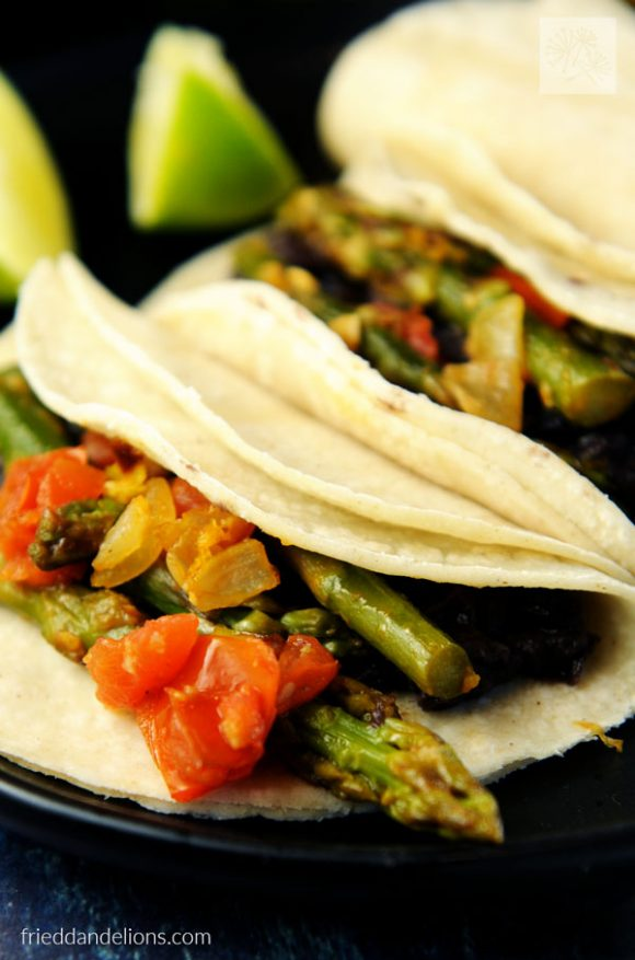 close up of braised asparagus tacos