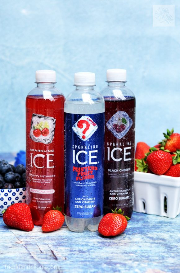 bottles of Sparkling Ice flavors with berries in the background