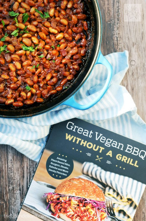 overhead shot of skillet with vegan baked beans and cookbook Great Vegan BBQ Without a Grill