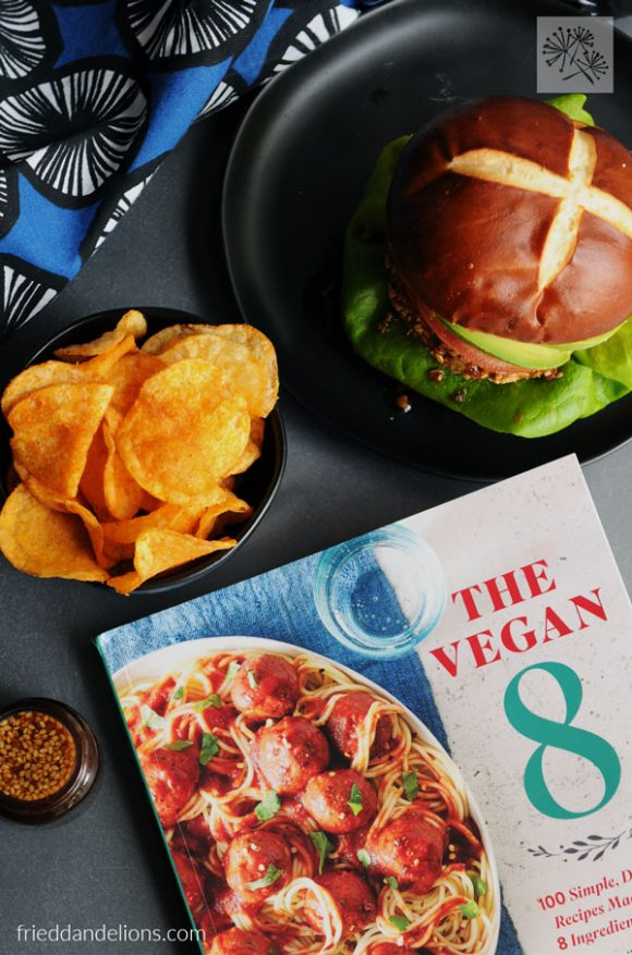 overhead view of teriyaki veggie burgers with The Vegan 8 cookbook on table