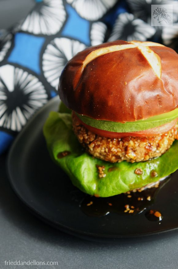 front view of teriyaki veggie burgers with blue napkin in background
