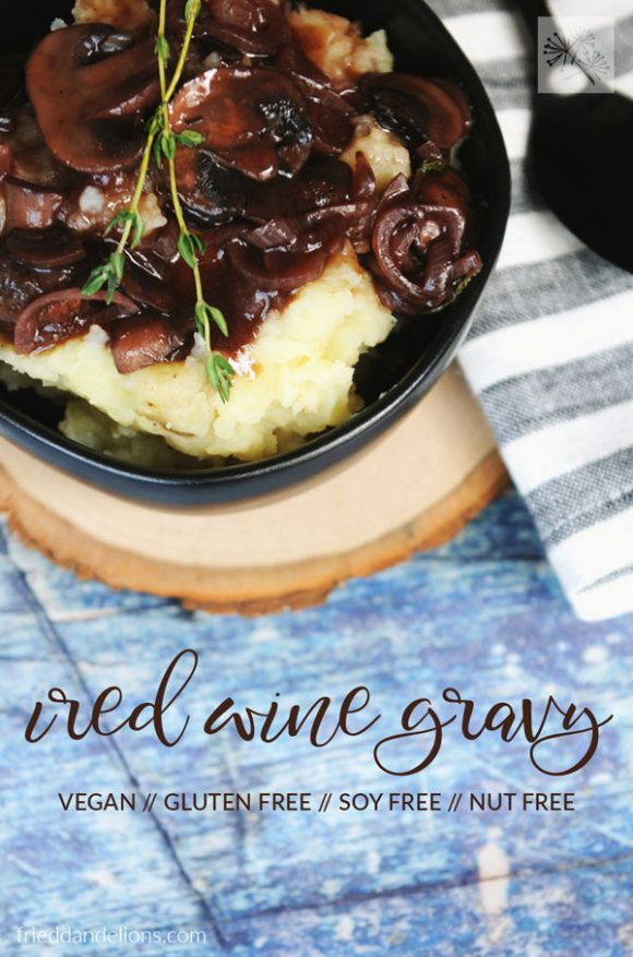 overhead shot of vegan red wine gravy with text overlay and blue background