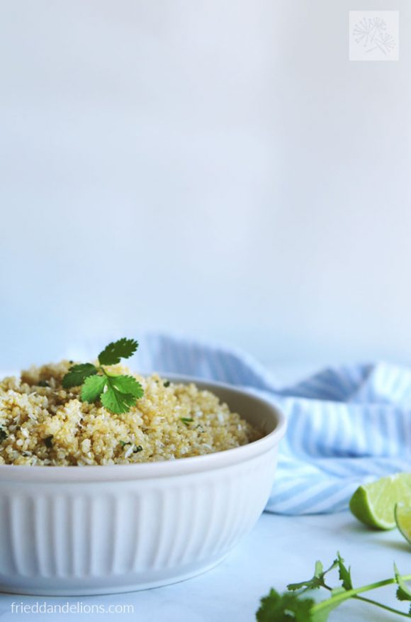 front view of bowl of Instant Pot Quinoa with blue and white napkin in the background