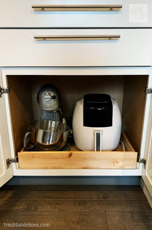 view inside appliance cabinet with mixer and air fryer in grey kitchen renovation