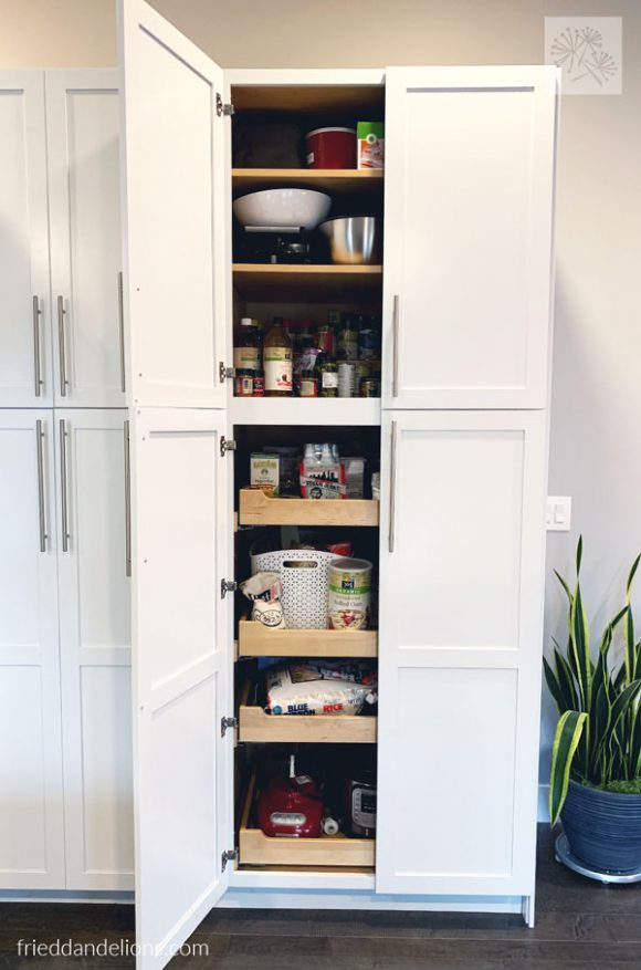 view of tall pantry cabinets in grey kitchen renovation