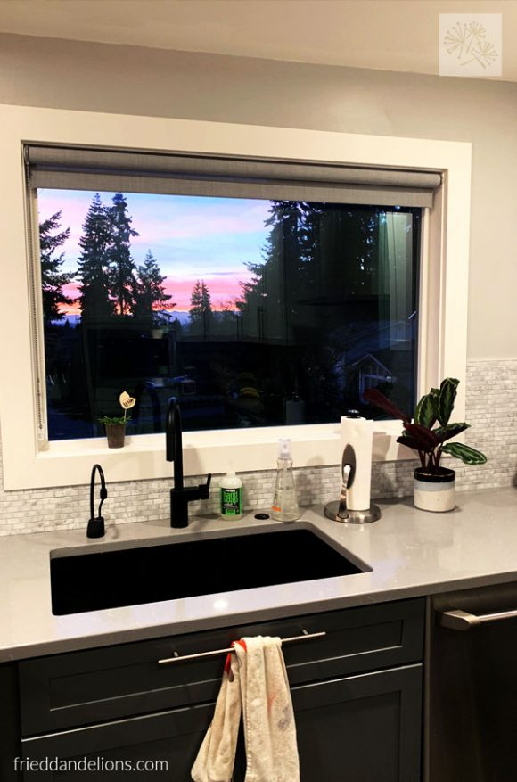 view of Pacific Northwest sunset from grey kitchen renovation