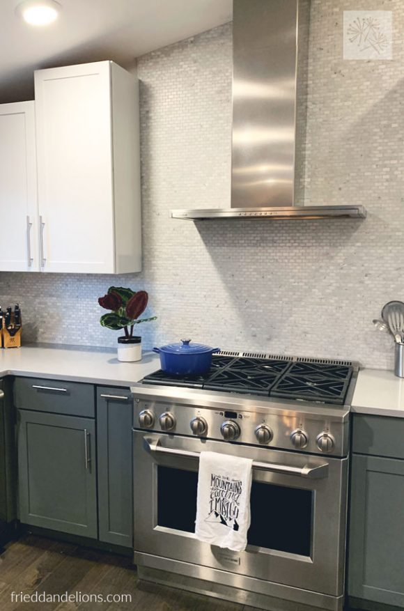 view of oven and exposed range hood in grey kitchen renovation
