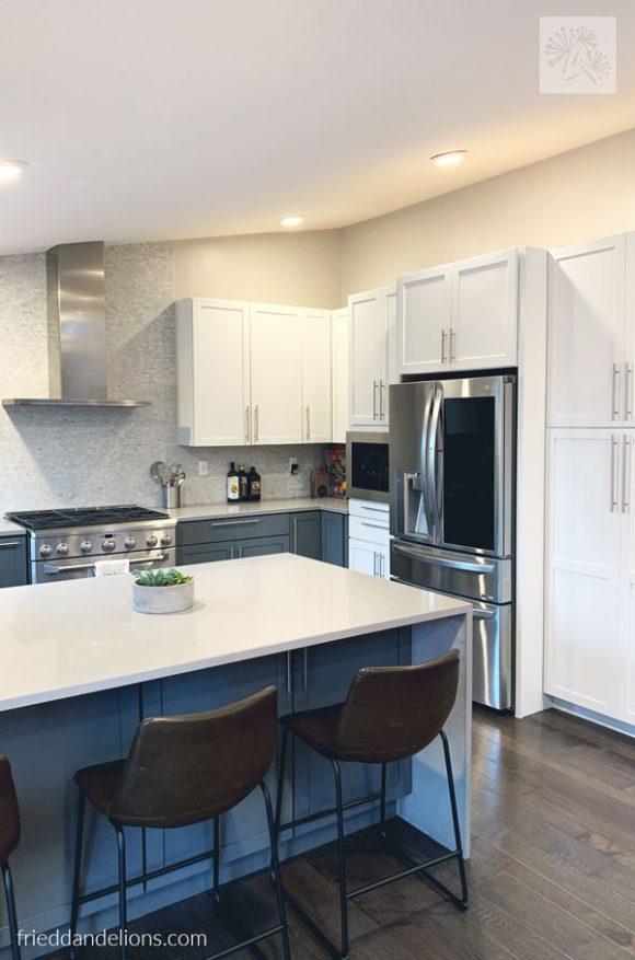 view of LG stainless steel fridge, exposed range hood, 6 burner stove in grey kitchen renovation