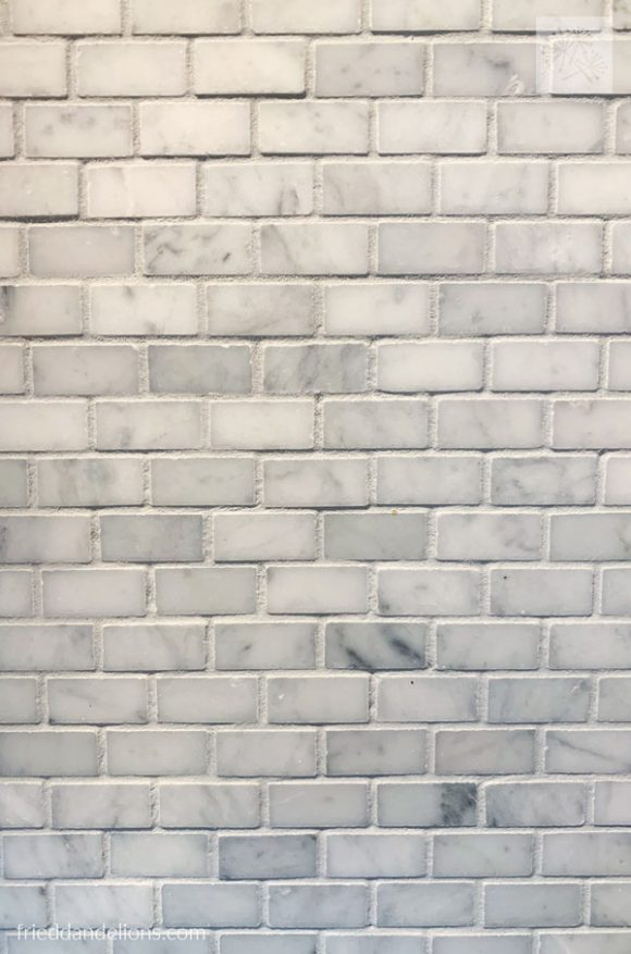 "small grey quartz subway tile in grey kitchen renovation 1/2"" x 1"""