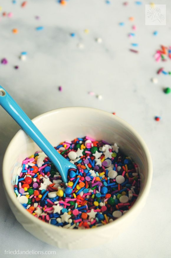 a bowl of sprinkles to decorate a vegan chocolate birthday cake