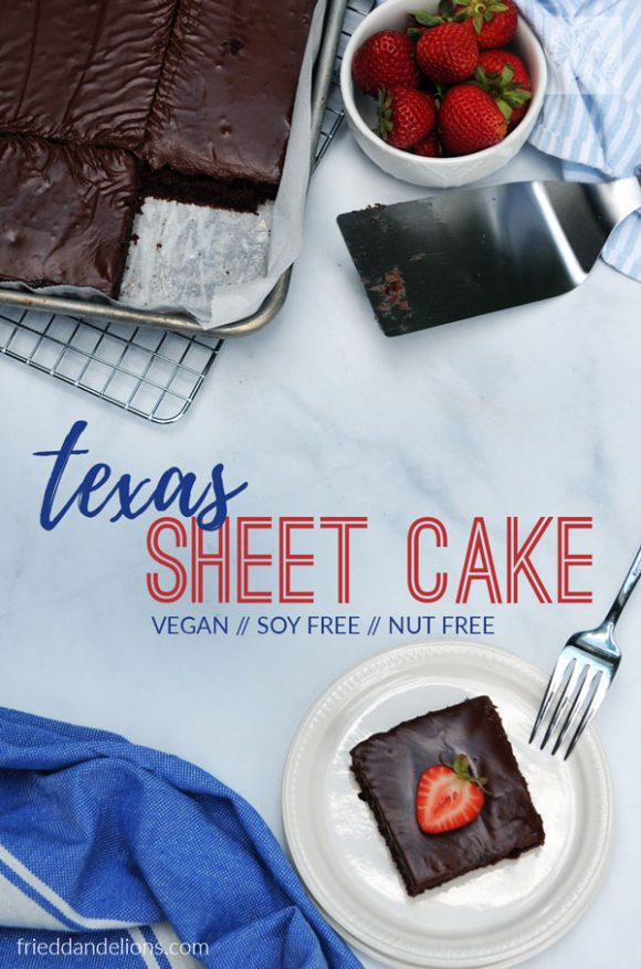 overhead view of vegan Texas Sheet Cake with text overlay, blue napkin, bowl of strawberries