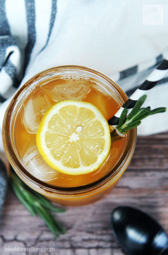 overhead view of jar of Rosemary Lemon Iced Tea with lemon garnish