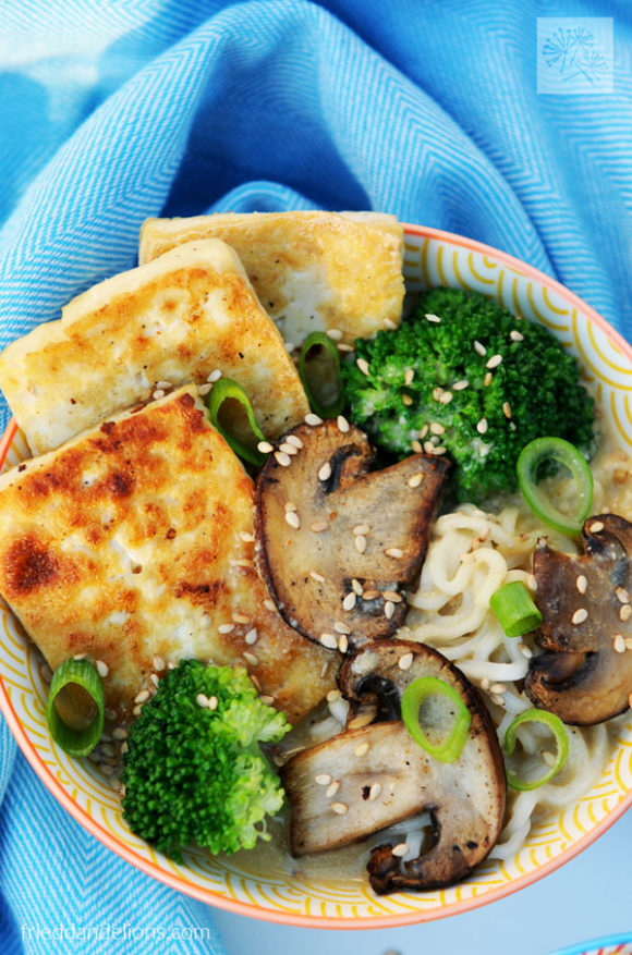 close up bowl of vegan creamy sesame ramen loaded with tofu, mushrooms, and broccoli